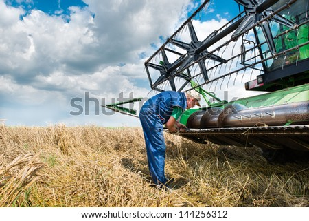 fixing header on old combine - stock photo
