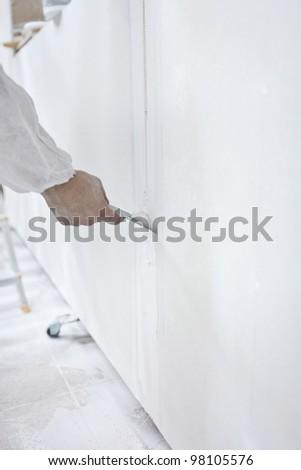 Fixing walls - stock photo