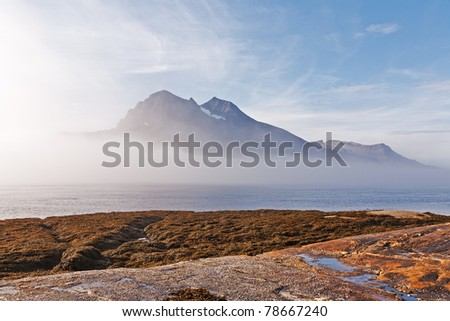 fjord landscape in Norway,fog - stock photo