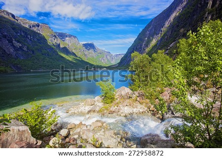 Fjord landscape with beautiful clouds and mountains. Norway.
