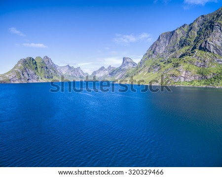 Fjord surrounded by high peaks on Lofoten islands in Norway - stock photo