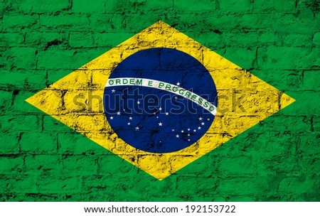 flag from Brazil  painted on a stone wall ; participant at the soccer games in Brazil  - stock photo