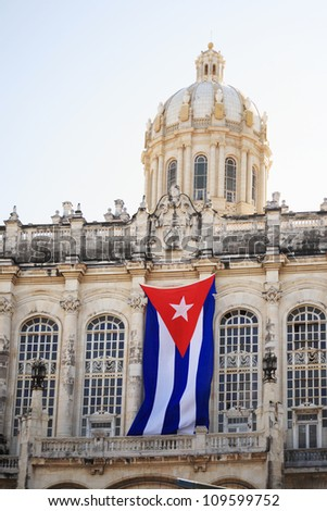 Flag hanging from the Revolution Museum Havana Cuba - stock photo