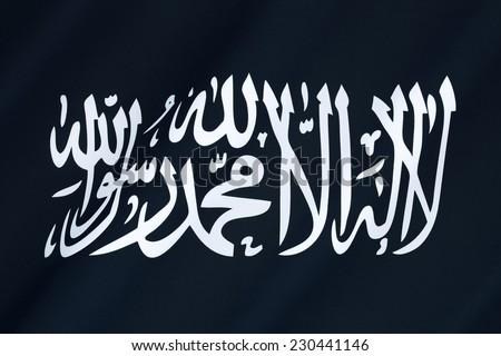 Flag of Al-Qaeda - Al-Qaeda is a global militant Islamist organization founded by Osama bin Laden and several other militants.  It operates as a militant Islamic fundamentalist group.  - stock photo