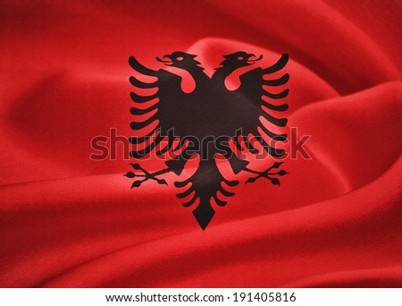 Flag of Albania waving in the wind. Silk texture pattern - stock photo
