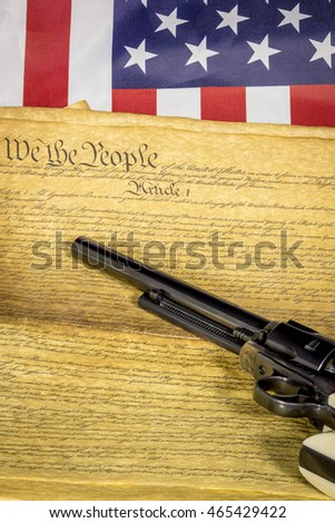 Flag of American with a pistol and constitution