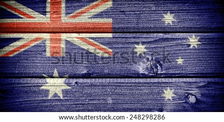 Flag of Australia painted on old grungy wooden  background - stock photo
