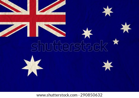Flag of Australia with vintage old paper - A Blue Ensign defaced with the Commonwealth Star - stock photo