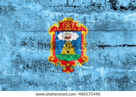 Flag of Ayacucho, Peru, painted on dirty wall