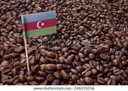 Flag of Azerbaijan sticking in roasted coffee beans.(series) - stock photo