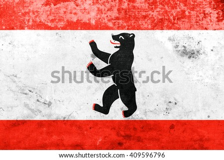 Flag of Berlin, with a vintage and old look - stock photo