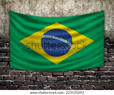 Flag of Brazil on old wall - stock photo