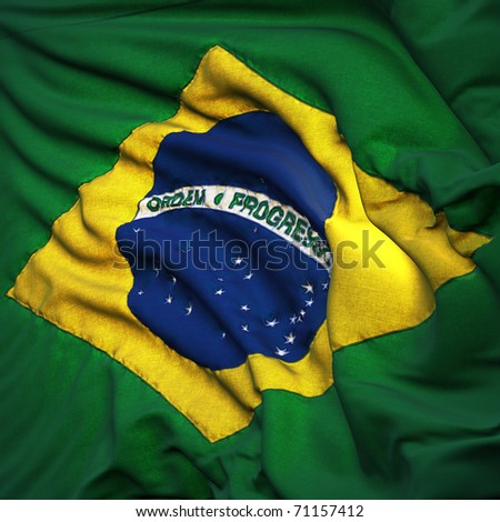Flag of Brazil. Sewn from pieces of cloth, a very realistic detailed state flag with the texture of fabric fluttering in the breeze, backlit by the rising sun light - stock photo