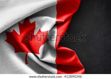Flag of Canada on blackboard background - stock photo