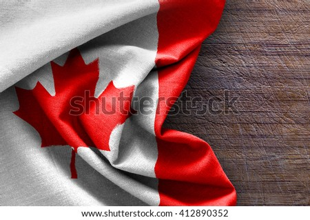 Flag of Canada on wood background - stock photo