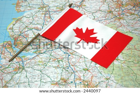 Flag of Canada over the map - stock photo
