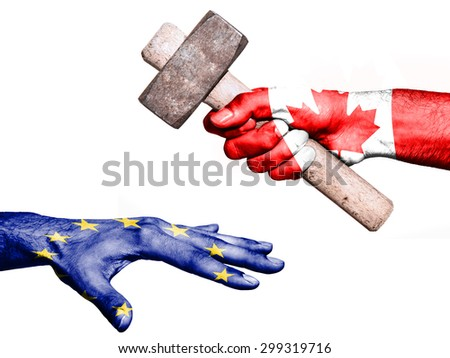 Flag of Canada overprinted on a hand holding a heavy hammer hitting a hand representing the European Union. Conceptual image for political, fiscal or social aggressions, penalties, taxation - stock photo