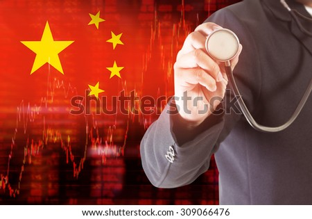 Flag of China. Downtrend stock data diagram with Businessman hand holding a stethoscope analyze solution ideas concept design - stock photo