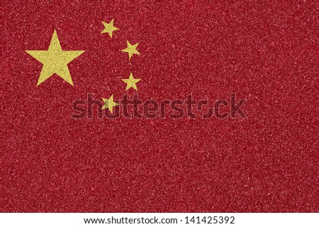 Flag of China made �¢??�¢??of colored decorative sand. - stock photo