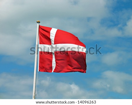 Flag of Denmark Danish blowing with blue sky background - stock photo