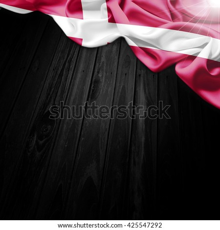Flag of Denmark on dark wood background