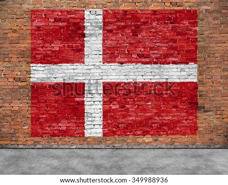Flag of Denmark painted on old brick wall