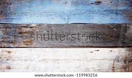 Flag of Estonia painted on grungy wood plank background - stock photo