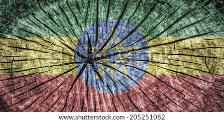 Flag of Ethiopia  on cracked wooden texture - stock photo