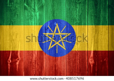 flag of Ethiopia or Ethiopia banner on wooden background