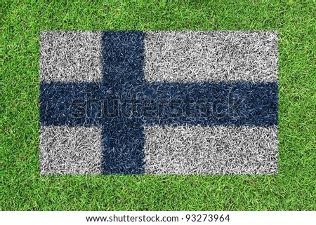 Flag of finland as a painting on green grass - stock photo