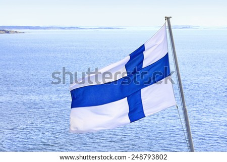 Flag of Finland on cruise ship in Aland Islands archipelago. - stock photo