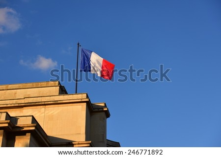 Flag of France flying proudly on top of a building - stock photo