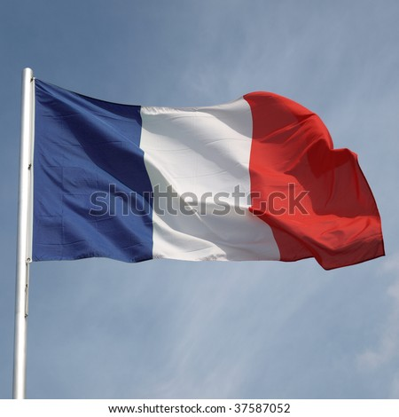 Flag of France over a blue sky - stock photo