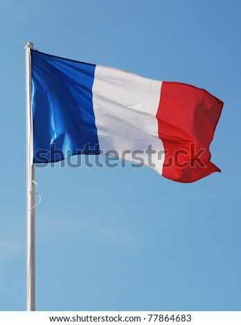 Flag of France waving against blue sky - stock photo