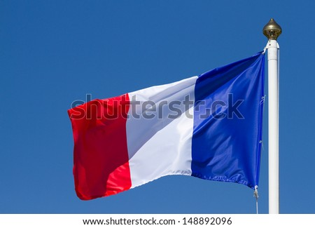 Flag of France, waving on the sky - stock photo