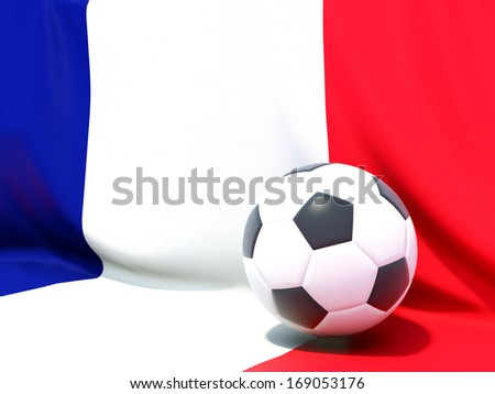 Flag of france with football in front of it