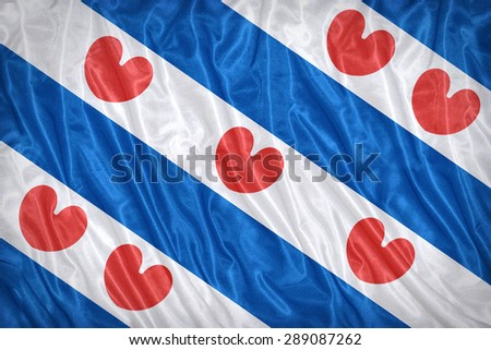 Flag of Friesland on the fabric texture ,vintage style - stock photo
