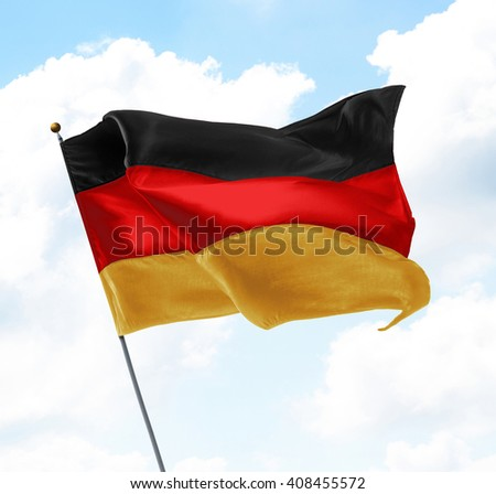 Flag of Germany Raised Up in The Sky - stock photo