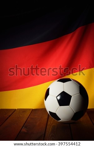 Flag of Germany with football on wooden boards as the background. MANY OTHER PHOTOS FROM THIS SERIES IN MY PORTFOLIO. - stock photo