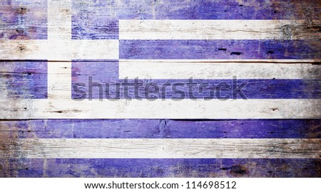 Flag of Greece painted on grungy wood plank background - stock photo