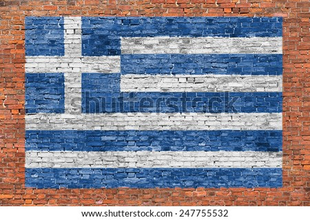 Flag of Greece painted over aged brick wall - stock photo