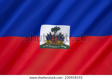 Flag of Haiti - Adopted 26th February 1986. The coat of arms depicts a trophy of weapons ready to defend freedom and a royal palm for independence. The palm is topped by the Cap of Liberty. - stock photo
