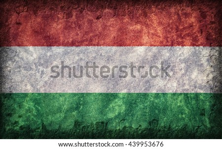 Flag of Hungary painted onto a rough wall - stock photo