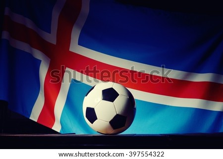 Flag of Iceland with football on wooden boards as the background. MANY OTHER PHOTOS FROM THIS SERIES IN MY PORTFOLIO. - stock photo
