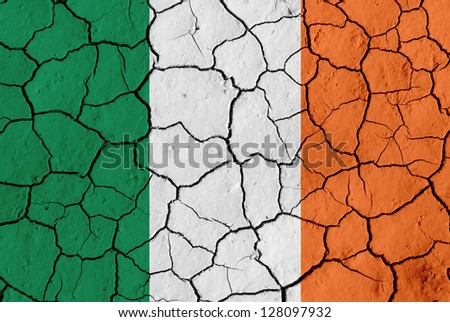 Flag of Ireland over cracked background, conceptual image of crisis - stock photo