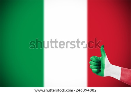 Flag of Italy over female's hand, focus set on hand - stock photo