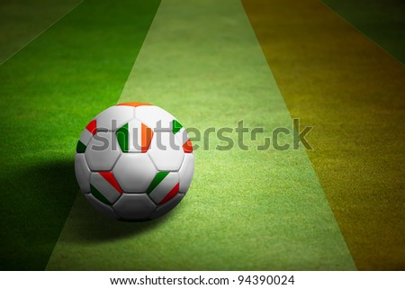 Flag of Italy with soccer ball over grass background - stock photo