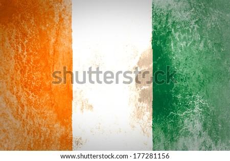 Flag of Ivory Coast overlaid with grunge paper
