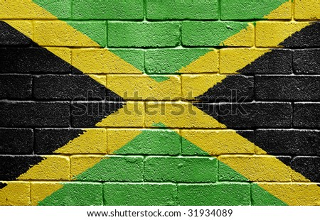 Flag of Jamaica painted onto a grunge brick wall - stock photo