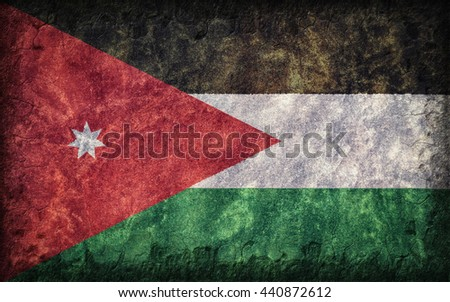 Flag of Jordan painted onto a rough wall - stock photo